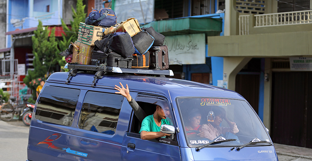 Angkot - (private minibus) taking passengers back and forth between towns and villages on Nias Island, Indonesia.