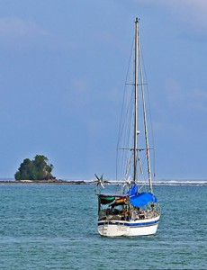 Sailing boat in Lagundri Bay, near the famous wave in Sorake.