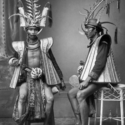 Studio portrait of two noble men warriors from South Nias. Tropenmuseum Collection.