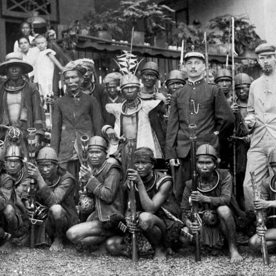 A band of Nias headhunters in a meeting with the Dutch. Tropenmuseum Collection.