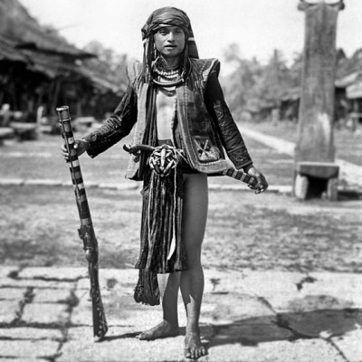 South Nias Warrior with a blunderbuss gun. Tropenmuseum Collection.