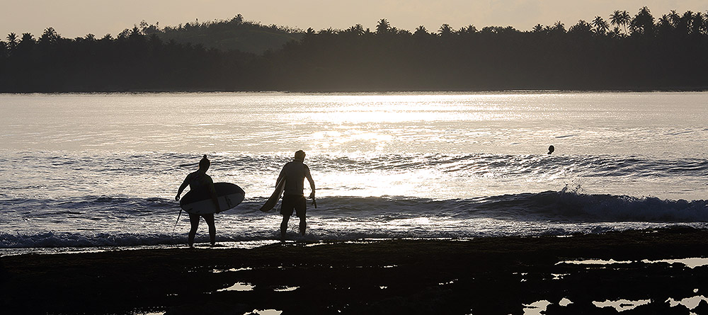 "Early morning surf at ""The Point"" in front of Sorake in Lagundri Bay."