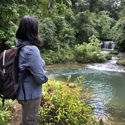 Hiking in the interior of Nias Island. Luaha N'droi waterfall, Alasa, North Nias.