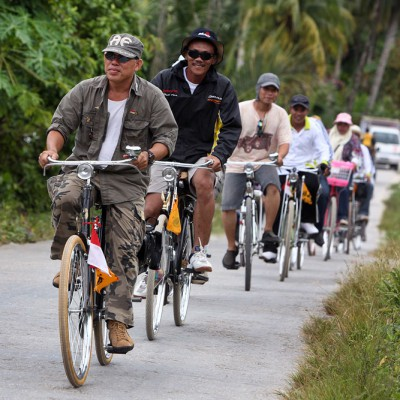A local bike club on a tour of North Nias. Many small roads across the island make Nias the perfect bike destination.